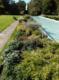 Formal garden with classical fountain Royalty Free Stock Photo