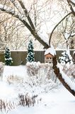 Beautiful quiet winter day. Formal garden covered with soft clear snow. Wintertime outdoors vertical image Stock Image