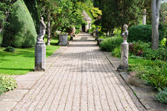 Formal Garden Pathway. Path in a Beautiful Green Formal Garden Stock Image