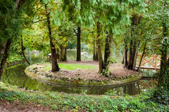 Formal garden with a small island in the pond Royalty Free Stock Photo