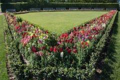 Formal garden with white bench garden Stock Photos