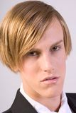 Formal Headshot. Portrait of young blonde male with intense look Royalty Free Stock Image