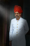 Formal India Clothing, Doorman Dressed Up. A man in India is dressed in traditional formal, dressed up attire while working as a doorman Royalty Free Stock Images