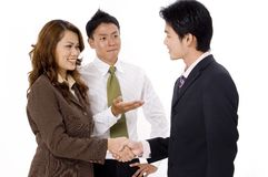 Formal Introduction. A businesswoman is introduced to a young businessman Royalty Free Stock Image