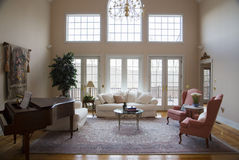 Formal Living Room. A bright formal living room in neutral colors with pink accents Royalty Free Stock Image