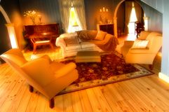 Formal lounge room. A very elegant old world type lounge room of a national heritage listed house. The warm colours make this a beautiful sitting room for stock photo