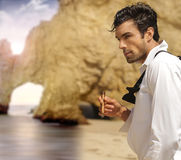 Formal man on beach Stock Images
