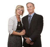 Formal mature couple. Formal couple posing together on white isolated background Royalty Free Stock Photography