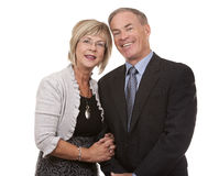 Formal mature couple. Formal couple posing together on white isolated background Royalty Free Stock Image