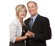 Formal mature couple. Formal couple posing together on white isolated background Royalty Free Stock Photos