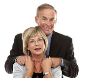 Formal mature couple. Formal couple posing together on white isolated background Stock Photos