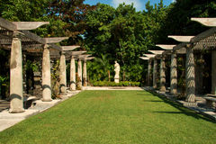 Formal Miami Garden. Unique architectural columns in this scene stock photo