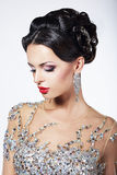 Formal Party. Gorgeous Fashion Model in Ceremonial Shiny Dress with Jewels Royalty Free Stock Photography