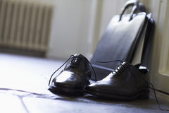 Formal Shoes And Briefcase On Floor Royalty Free Stock Photos