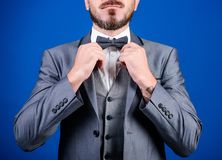 Formal suit jacket close up. Male fashion and aesthetic. Businessman formal outfit. Classic style aesthetic. Perfect. Suit fit him. Menswear shop. Hands fixing royalty free stock image
