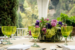 Formal table setting for a wedding with flowers stock images