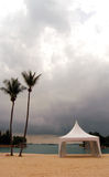 Formal tent on beach. A white formal tent on beach.  A suitable type of tentage for a variety of outdoor functions such as weddings, parties, gatherings, buffets Stock Image