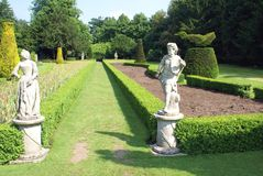 Formal topiary garden with statues Stock Photography