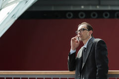 Formal wear Businessman talking on phone Stock Photo