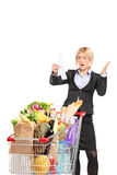 Formal woman looking at the shopping bill in disbelief Stock Images