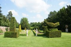 Yew topiary garden with statues Royalty Free Stock Photos