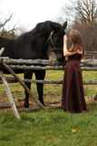 Formal young lady and her horse Stock Photo