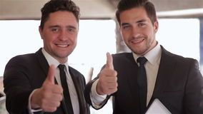 Formally dressed businessman thumbs up stock footage