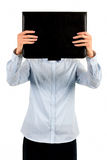 Formally dressed girl covering face. Stock Photo