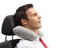 Formally dressed guy with a neck pillow sleeping Stock Images