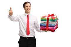 Formally dressed man with a stack of ironed and packed clothes m Royalty Free Stock Photos