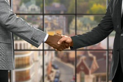 Formally dressed men shaking hands. royalty free stock image