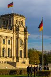 Formally dressed people going to the German Parliament. Berlin, Germany, 10.04.2017, Formally dressed people going to the German Parliament. Waving national royalty free stock images