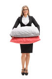 Formally dressed woman with pillows. Full length portrait of a formally dressed woman with pillows isolated on white background royalty free stock image