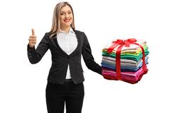 Formally dressed woman with a stack of clothes wrapped with red Royalty Free Stock Photos