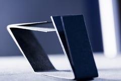 Formas de papel azul marino y sombras Imagen de archivo