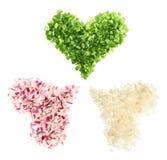 Formas del corazón hechas de cortar verduras Fotos de archivo