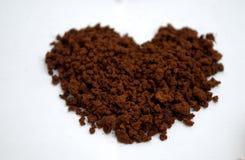 Formas do coração feitas do pão-de-espécie e do café Foto de Stock