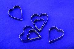 Formas do coração no azul Imagem de Stock Royalty Free