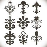 Formas negras de la flor de lis fijadas ilustración del vector