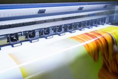 Format large inkjet printer working on vinyl banner stock photos