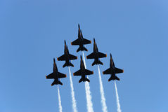 Formation. A formation of airplanes on a blue sky Stock Image