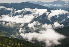 Formation of clouds in the mountains Royalty Free Stock Photos