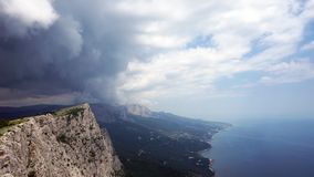 The formation of clouds between the mountains and the sea. Black Sea. Summer.Timelapse stock video footage
