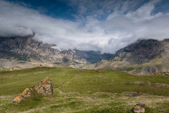 The formation of clouds over alpine meadows. Royalty Free Stock Photo