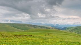 The formation of clouds over alpine meadows, storm clouds. Time lapse. Russia, the Caucasus Mountains, Kabardino-Balkaria. The formation of clouds over alpine stock video footage