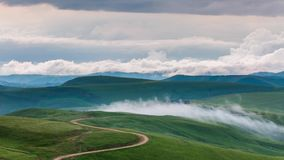The formation of clouds over alpine meadows, storm clouds. Time lapse. Russia, the Caucasus Mountains, Kabardino-Balkaria. The formation of clouds over alpine stock video