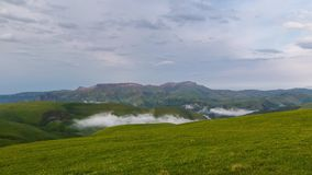 The formation of clouds over alpine meadows, storm clouds. stock video footage