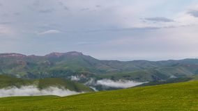 The formation of clouds over alpine meadows, storm clouds. stock footage