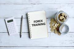 Formation de forex écrite sur un carnet images stock