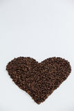 Formation de grains de café en forme de coeur Images stock